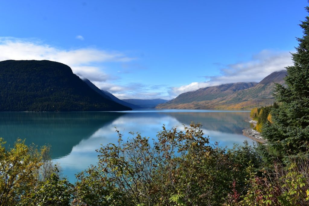 Teal water due to the lake being fed by a glacier
